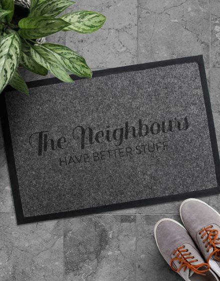 The Neighbours Have Better Stuff Door mat