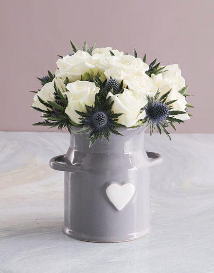 White Roses In Ceramic Milk Can