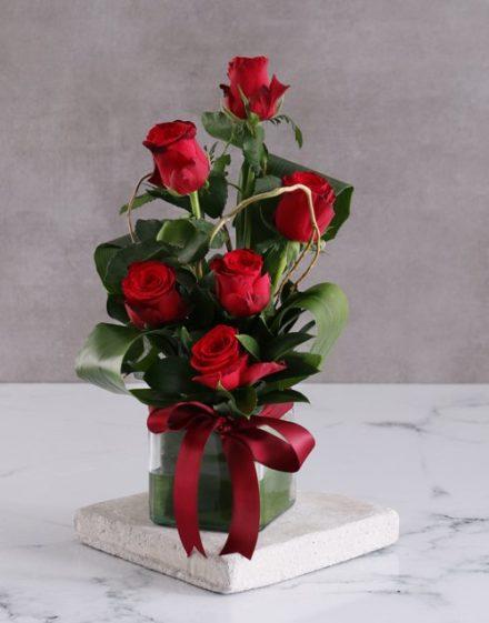 Red Roses In Square Vase