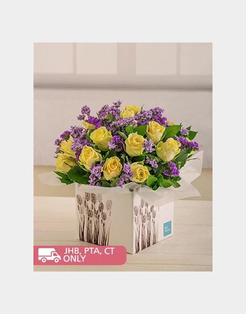 roses Cream Roses and Purple Filler in Box