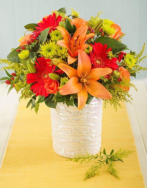 Fiery Mixed Flowers in Glazed Vase